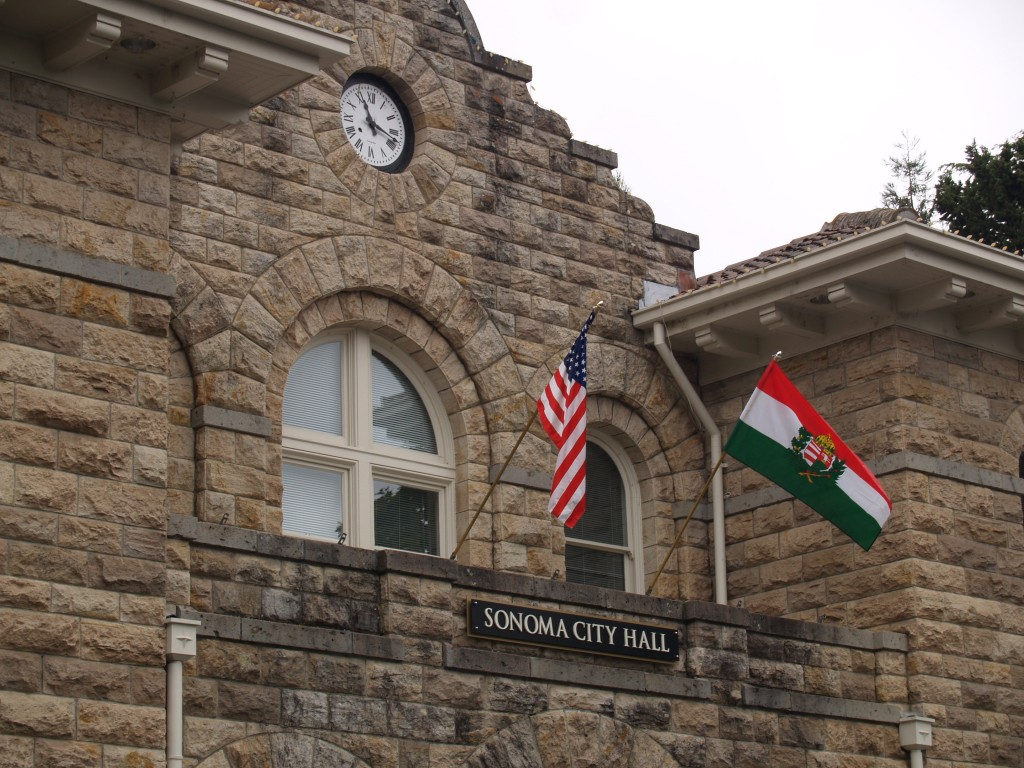 US and Hungarian flags on Sonoma's City Hall