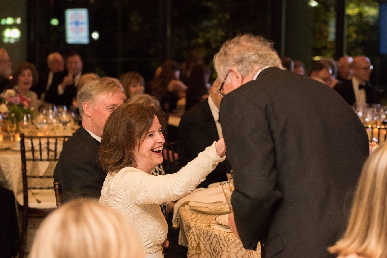 Mr. John N. Lauer gives Ambassador April H. Foley a hand-kiss