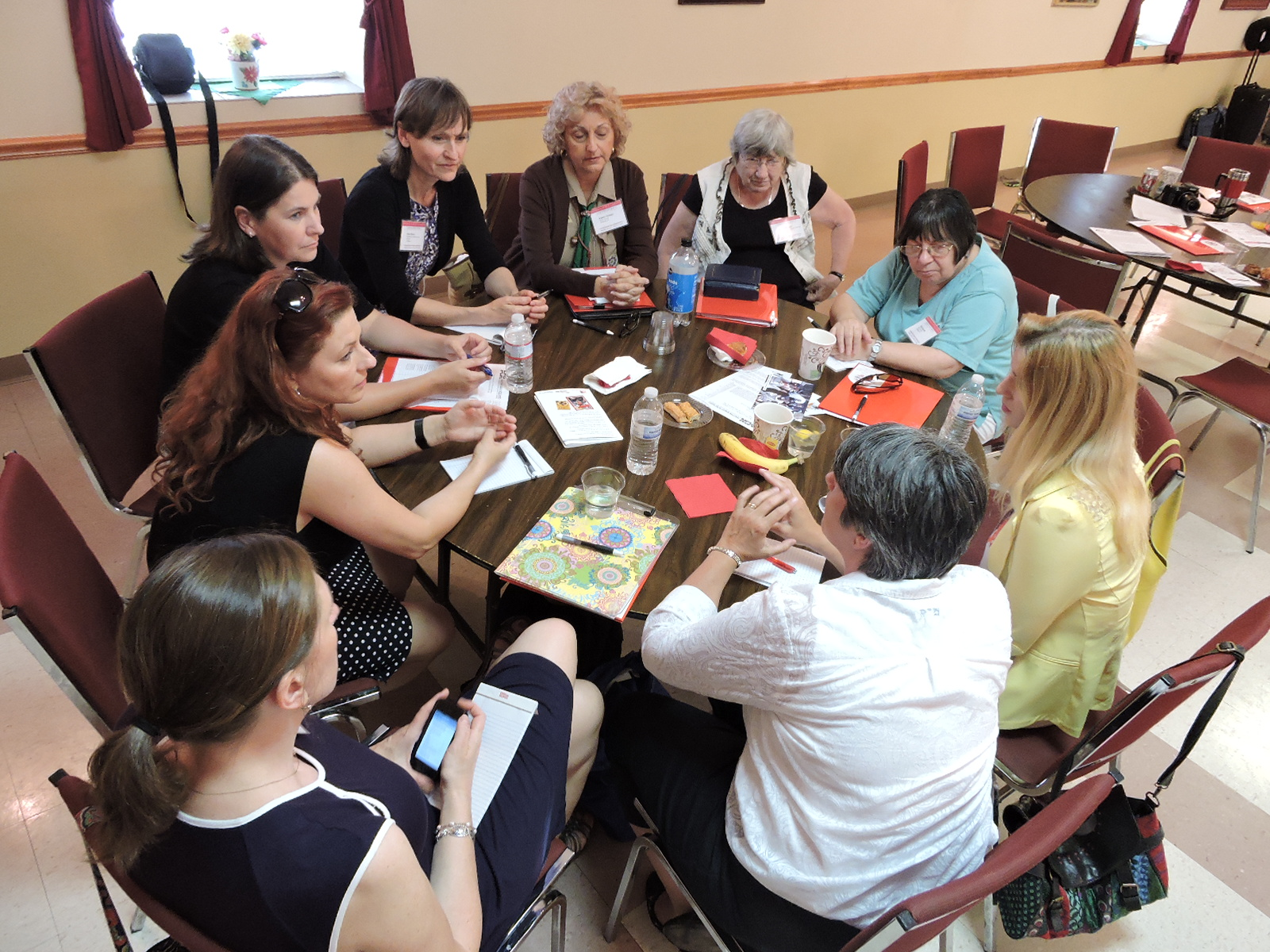 HATOG IX attendees participating in a workshop