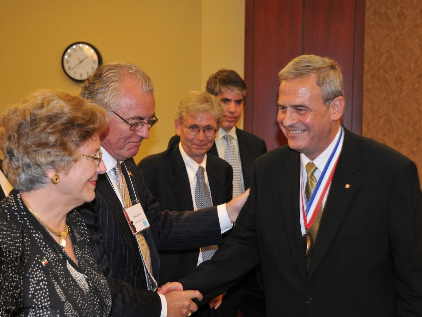 Mrs. Edith Lauer, Mr. John Lauer, Mr. László Hámos and Mr. Maximilian Teleki congratulate to Bishop Tőkés Truman-Reagan Freedom Medal VOC