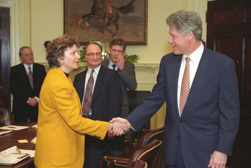 Edith K. Lauer and President Bill Clinton at a discussion about NATO expansion in 1994
