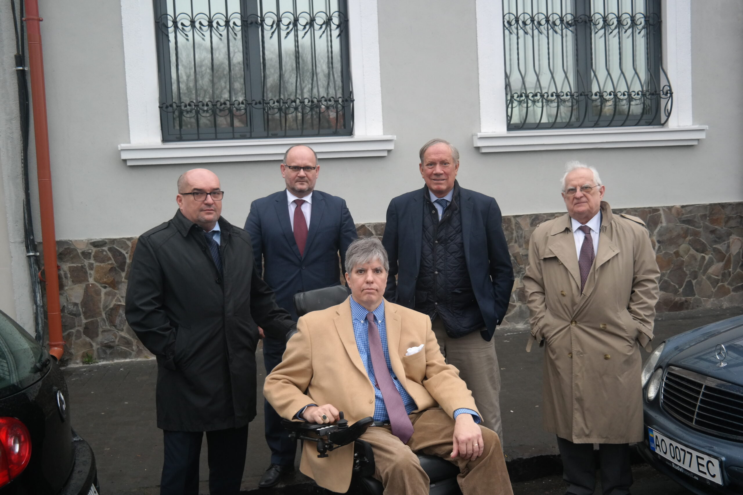 Dr. László Brenzovics, György Kota, Gov. George Pataki, Zsolt Szekeres and Maximilian Teleki in front of the recently restored head office of the Cultural Alliance of Hungarians in Sub-Carpathia (KMKSZ) in downtown Ungvár (Uzhgorod) on March 10, 2019