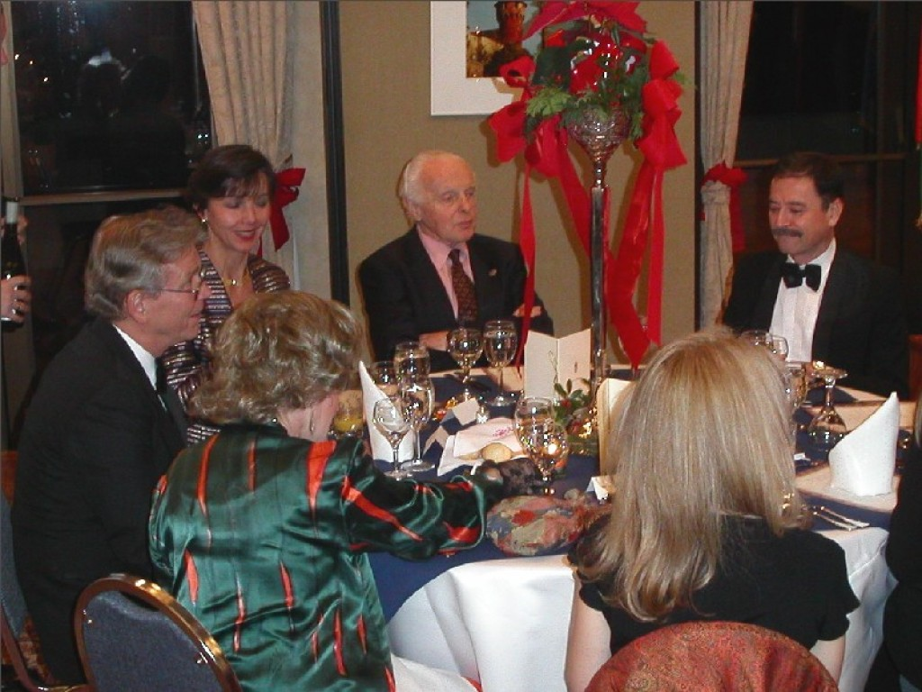 Dinner table with Mr. László Hámos, Congressman Tom Lantos, Ambassador András Simonyi, and family members